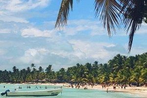 People walk on golden beach