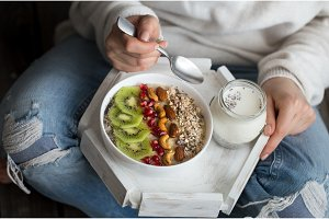 healthy breakfast at the girl in hands,