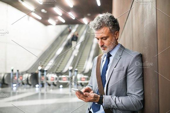 Businessman In Front Of Escalators On A Metro Station