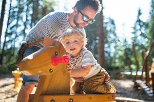Father with little boy on the playground.
