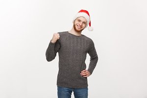 Holiday Concept - Young beard man in sweater showing hand up with exciting feeling.