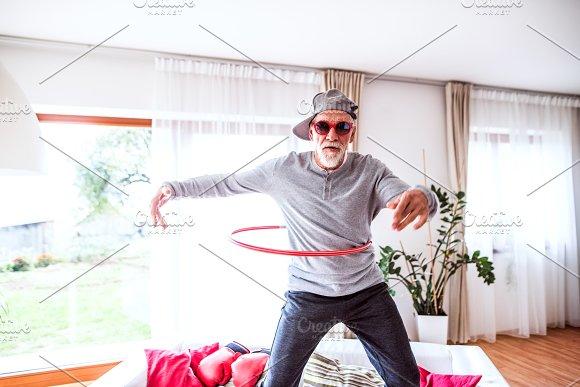 Senior man having fun at home. in Graphics