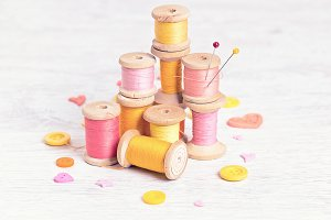 spools  threads in yellow-red colors