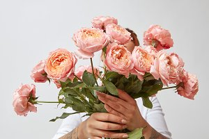 bouquet of fresh pink roses, holding a girl