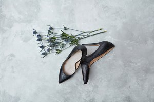 blue flowers and black female shoes