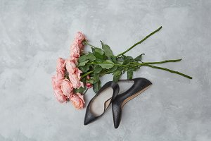 bouquet of pink roses and women's shoes