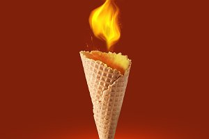 wafer cone with fire on color background