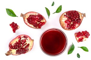 A glass of pomegranate juice with fresh pomegranate fruits isolated on white background. Top view. Flat lay