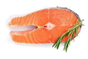 Slice of red fish salmon with rosemary isolated on white background. Top view. Flat lay