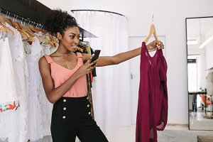 Fashion designer taking photograph
