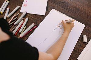 Female entrepreneur sketching