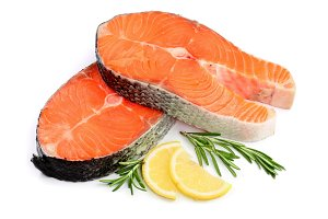 Slice of red fish salmon with lemon and rosemary isolated on white background