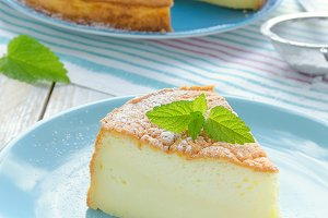 Japanese cheesecake decorated with mint and strawberry