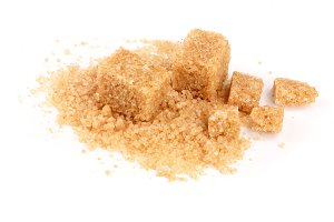 brown sugar heap isolated on white background