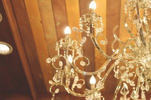 chandelier and wood ceiling