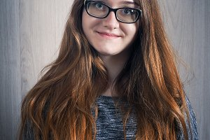 Portrait of a beautiful young girl with glasses