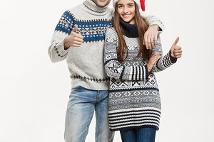 Christmas concept - Full-length Young attractive caucasian couple giving a hug celebrating for Christmas day.