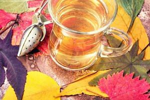 Autumn composition with autumnal tea