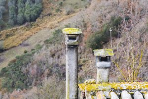 two old ruined chimneys
