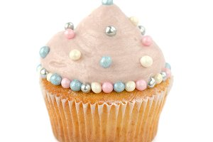 Cupcake decorated with cream and sugar pearls