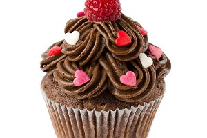 Chocolate cupcakes decorated with sugar hearts and raspberry