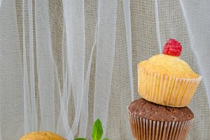 Different types of freshly baked muffins or cupcakes