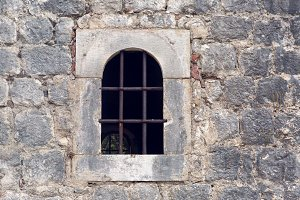 window with grate in old building in Montenegro