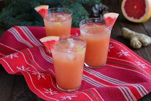 Grapefruit cocktail on festive Christmas background