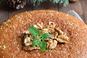 Homemade Honey and walnut pie on wooden background