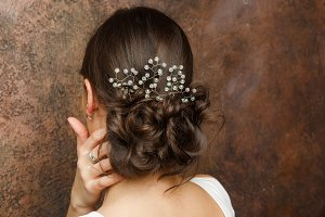 Image from back of girl with hairdo and diadem
