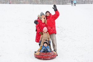 Image of family walk with daughter and son on tubing in winter park