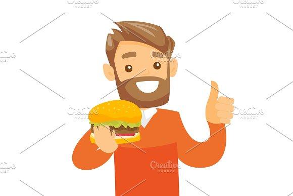 Young Caucasian White Man Eating Hamburger