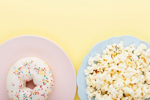 donut and popcorn yellow background