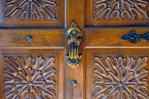 part of old wooden door with carved