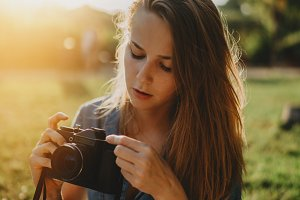 Beautiful girl with film camera