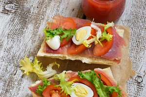 Sandwich with ham, eggs and tomato