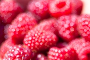 Red raspberries. Blurred