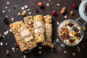 Granola bars on dark stone table. Top view.