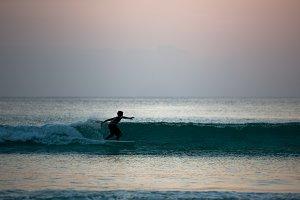 Boy surfing on a board