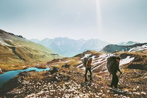 Couple backpackers hiking
