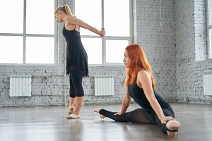Two girls dancers warming up before a workout