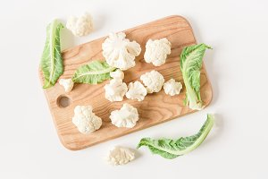 Fresh cauliflower on the wood.