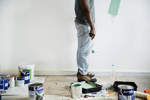 Man painting house wall