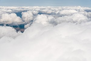 White Cumulus Clouds seen from Window of Airplane