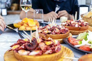 People eating Pulpo a la Gallega
