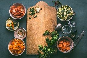 Healthy food around cutting board