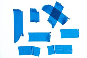 Set of blue masking tape pieces
