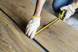 Carpenter installing wooden floor