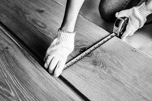 Carpenter installing wooden floor