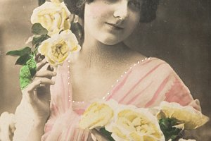 Lovely girl with roses in 1913